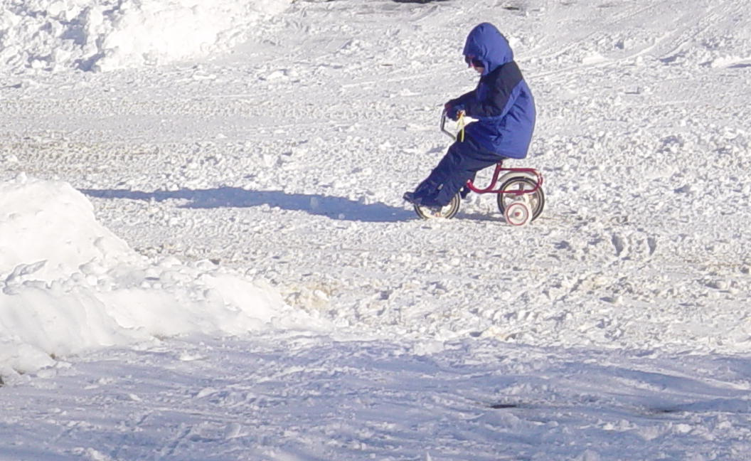 riding a tricycle through the snow