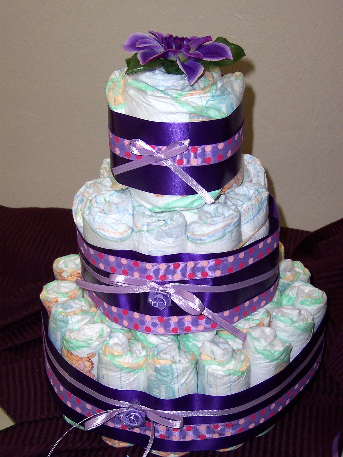 sweet yums baby girl diaper cake