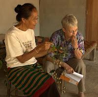 Pii Yai offers Alleson a ripe ebony fruit