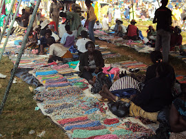 Women at the markets selling bead necklaces