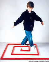 NAMC montessori classroom observing sensory processing disorder boy walking red rod maze