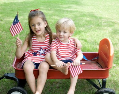 NAMC montessori classroom activities fourth of july kids in wagon