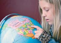 NAMC montessori us history thanksgiving activities girl with globe