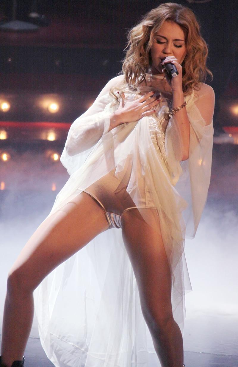 Miley+Cyrus+-+Oops+-+2010.11+-+00.jpg