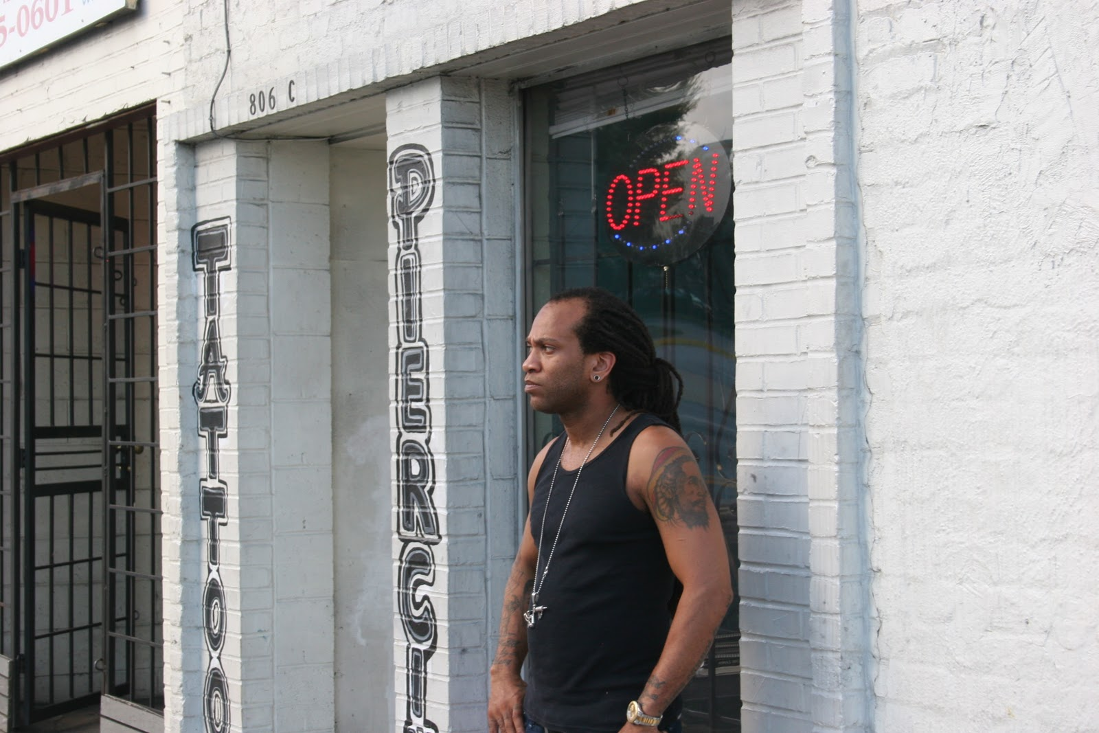 ... tattoo operates a store front salon specializing in tattoo and body