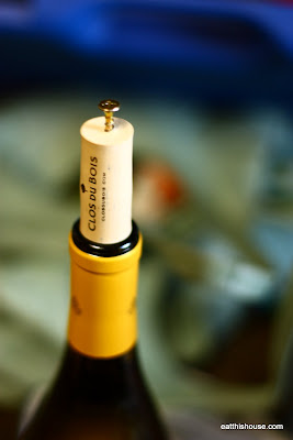 opening a wine bottle without a corkscrew