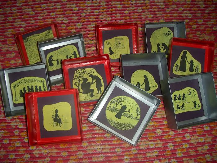 História de Sheilinha em tampas de caixas