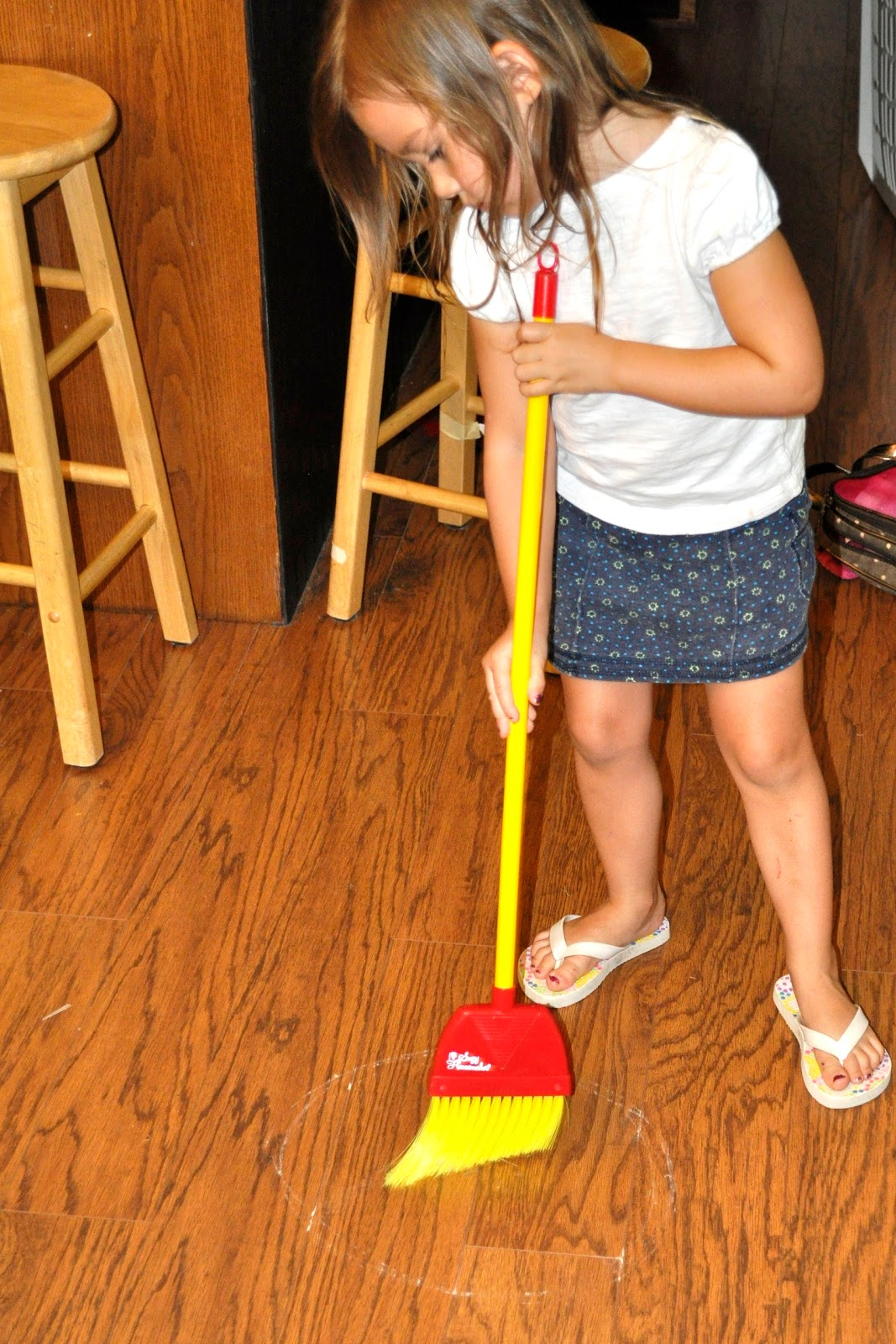1) Draw A Chalk Circle On The Floor In The Room You Want Your Child To Sweep .