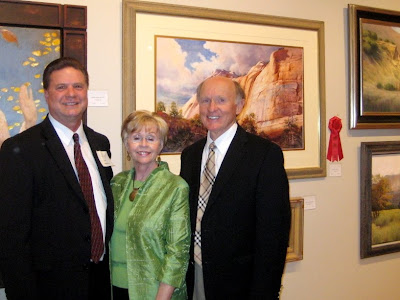 Artist Roland Lee with the Bensons who purchased his award-winning painting at the Dixie College Sears Invitational Art Exhibit
