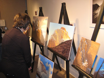 Guests get a closeup view of Dennis Farris paintings in progress at Southern Utah University presentation