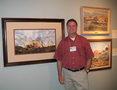 Roland Lee with painting of West Temple owned by Zion Natural History Association on exhibit at A Century of Sanctuary Zion Centennial Art Show