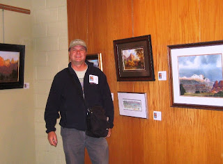 Roland Lee with his painting of the Watchman in Zion National Park