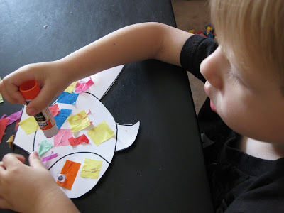 Evan made a rainbow fish using a fish outline, cut up tissue paper,