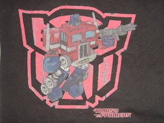 Optimus Prime Red Logo, in old school pose.