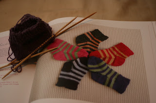 here are some socks i ve started for baby y i usually detest making ...
