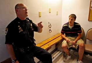 St. George Police Chief Scott Uhrig talks with Brett Darrow