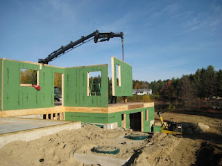 picture of crane erecting prefabricated wall panels