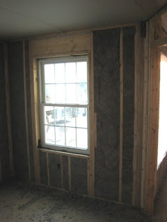 picture of wall cavity with nu-wool cellulose insulation