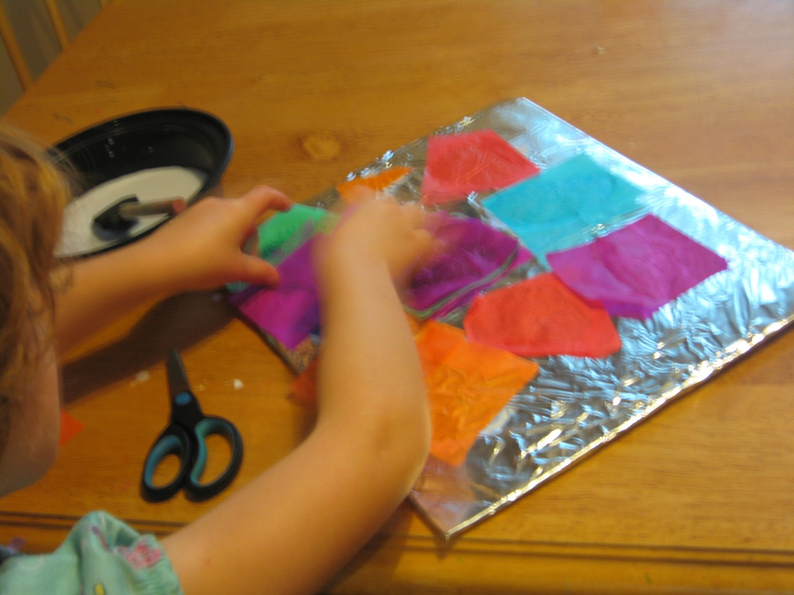 tissue paper crafts How to make a tissue paper suncatcher with wheat paste on wax paper this easy kids craft uses materials you likely have and is eco-friendly and beautiful.