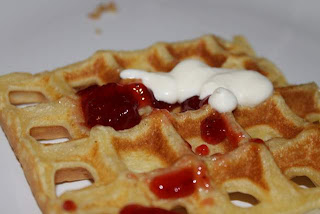 Waffles with jam and whipped cream