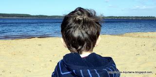 Bjorn contemplating the blue water at Léon lake
