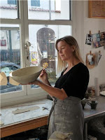 Lena Balthazard working with pottery