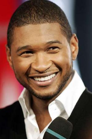 Usher. He's not really a romantic hero, but that smile could launch a ...