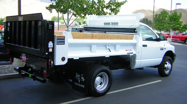harbor truck bodies blog rugby steel fold  side dump  lift  dump liftgate