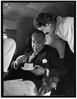 An Attentive Swissair Air Hostess Serves a Smart Gentleman a Cup of Coffee