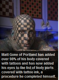 Man tattoos eyeballs.