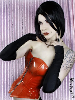 Goth model in rubber coreset and gloves