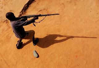 A child soldier in northern Uganda. Photo by Jon Warren, copyright 2008 World Vision.