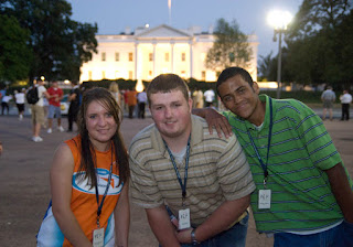 Valerie Riccio, Aaron Kittle, and Rodney Feaster, of the Appalachia delegation, visit the White House on the night time tour of the D.C. monuments