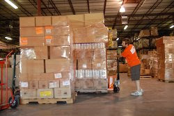 World Vision employee, Jeremy Wissink, readies supplies for transport to the Texas coast.