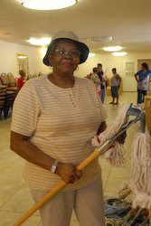 Eva Bosley checks out one of the mops, which was just delievered by World Vision to Greater First Baptist Church in Houston, Texas.