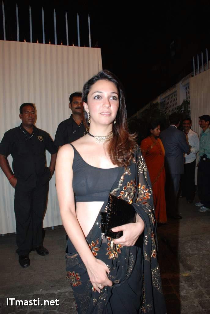Actress In A Transparent Dress  Wearing Saree   Blouse  Without A Bra