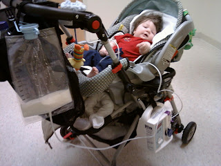 gtube feeding baby Mason in the stroller