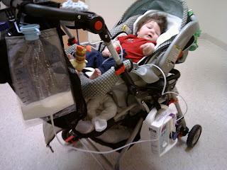 gtube feeding baby Mason in the stroller