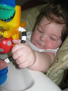 visually impaired baby Mason with high contrast toys