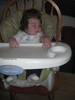 baby Mason in highchair