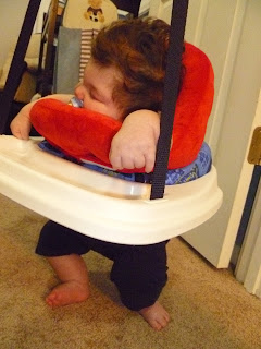 hugga-bebe pillow supporting hypotonia baby in doorway swing