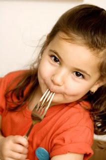 child eating narrowweb  300x450 0
