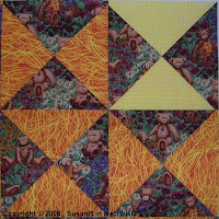 detail view of Easy X quilt top with bear fabric