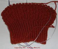 half done waffle-weave cap in rust