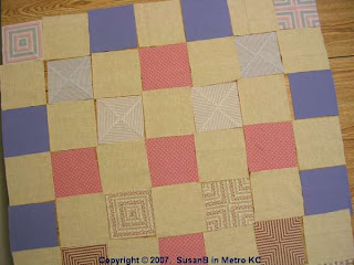 squares arranged into quilt top