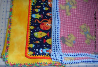 3 fleece blankets with crocheted edgings