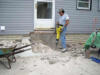Working to remove broken cement steps