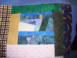 My scrappy quilt has a newly titled category: The Improv Quilt.