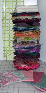 Measuring my big pile of pre-cut five inch quilt squares - nearly 16 inches high.