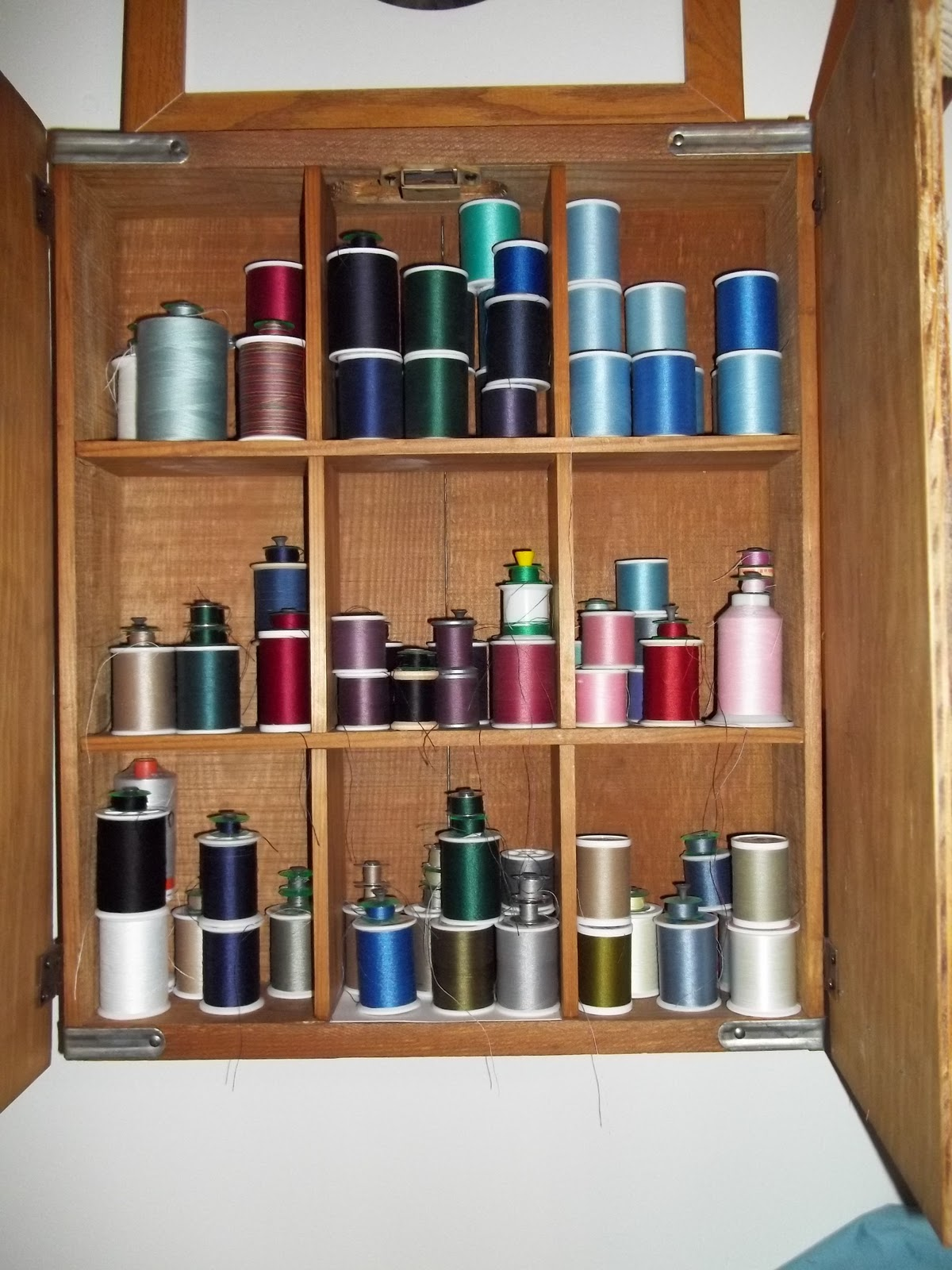 Sewing Thread Storage Wall Cabinets http://365daysotherramblings.blogspot.com/2011/02/cleaning-sewing-room.html